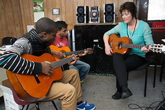 Students learning music with teacher at Bergen Center for Child Development - private special education school in Haworth NJ